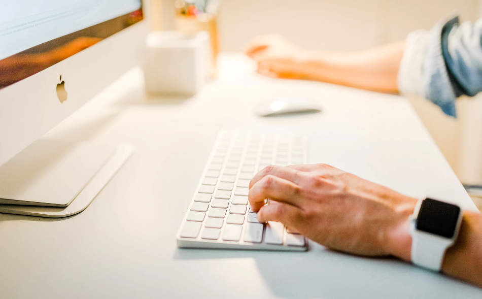 man using a desktop computer