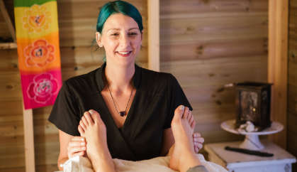 massage therapist during a session for deep tissue massage